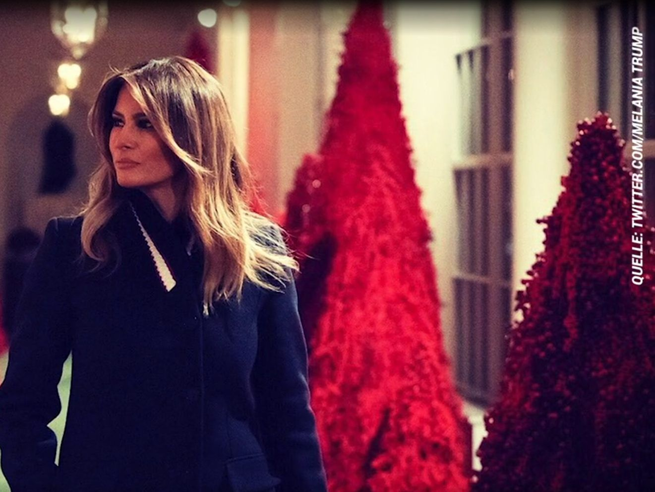 first lady melania trump taucht das wei e haus in rot stars vol at. Black Bedroom Furniture Sets. Home Design Ideas